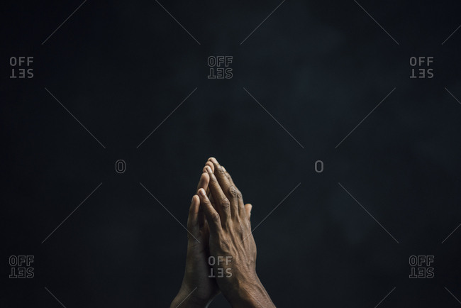 Hands of man and black background