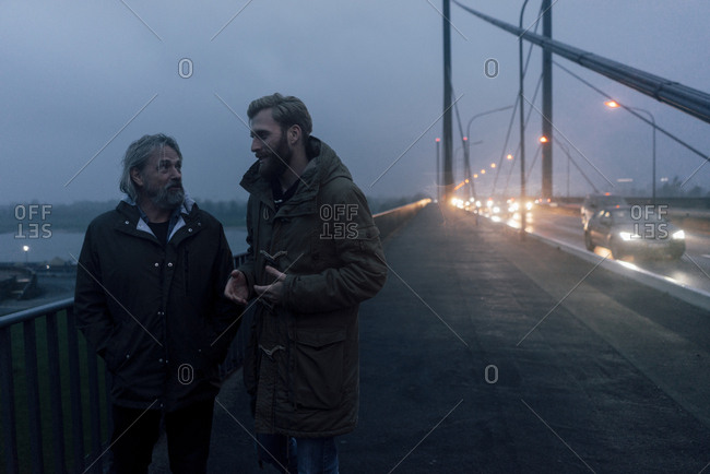 Father and son meeting on bridge- discussing business