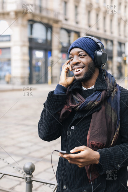 African American man with smartphone and headphone