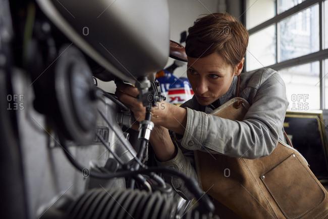 Woman working in repair workshop