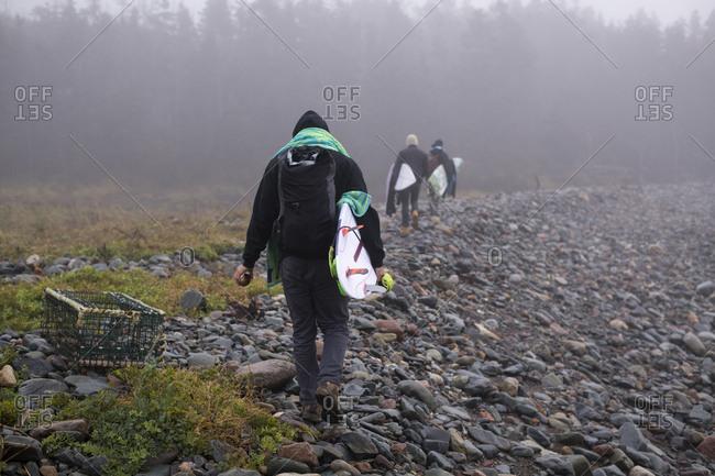 Young Men exploring Nova Scotia for a travel surf trip