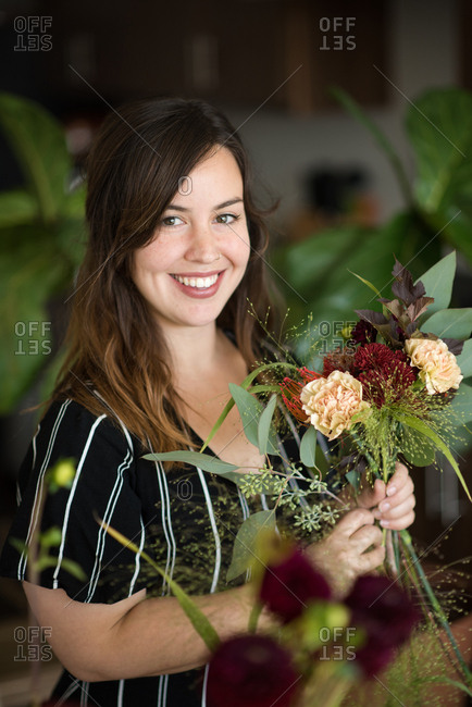 Portrait of woman smiling with bouquet