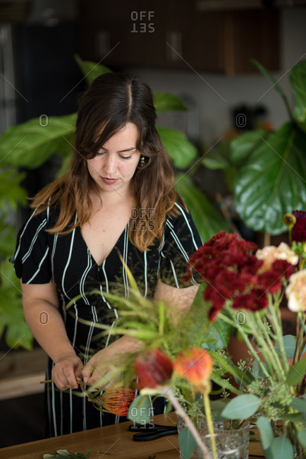 Woman pruning flowers for bouquet