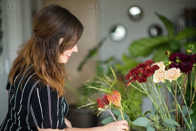 Side profile of woman assembling bouquet