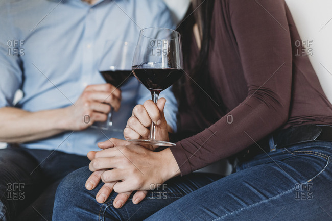 Young couple drinking red wine in a relaxing moment