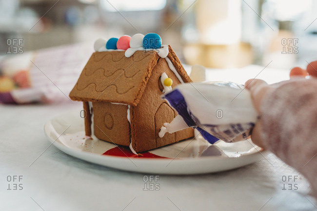 Gingerbread House being Iced