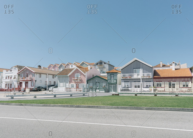 September 10, 2019: View of striped houses at the roadside- Costa Nova- Portugal