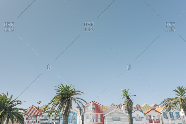 September 10, 2019: View of striped houses with palm trees- Costa Nova- Portugal