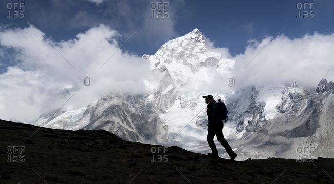 Woman trekking with Mt Everest- Nuptse and Kala Patthar in background- Himalayas- Solo Khumbu- Nepal