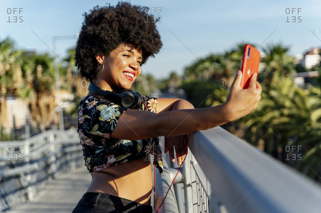 Smiling Afro-American woman taking a selfie