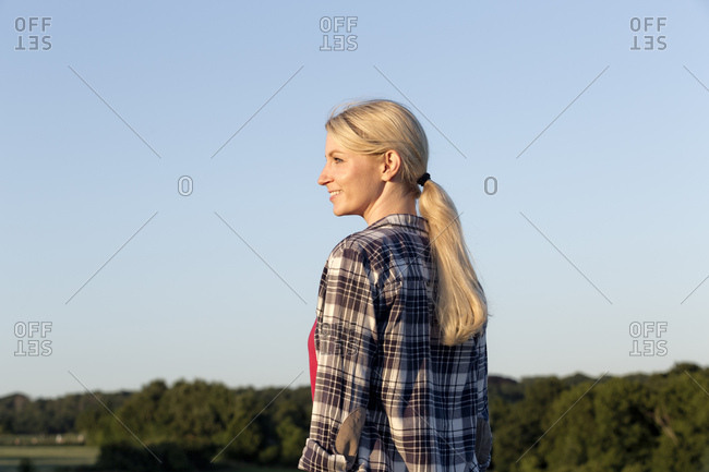 Smiling young woman enjoying nature