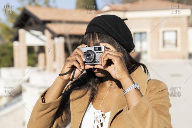 Female tourist taking a photo outdoors