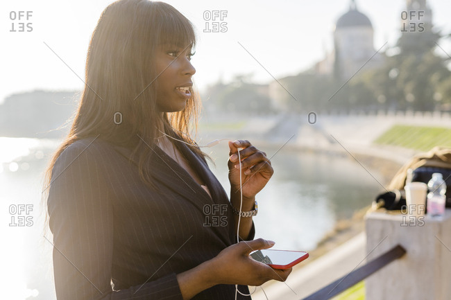 Businesswoman on her smartphone outdoors