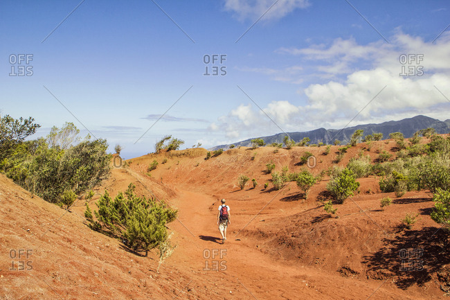 Hiker on red soil- Agulo- La Gomera- Canary Islands- Spain