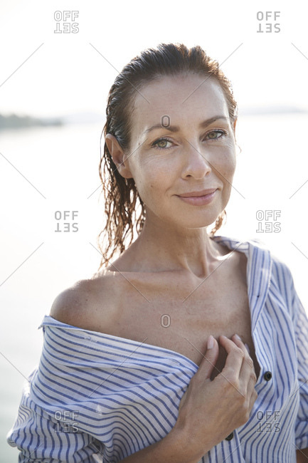 Portrait of mature woman with wet hair at a lake