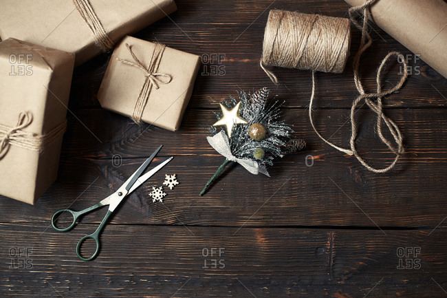 Christmas gift boxes and rope on a wooden table