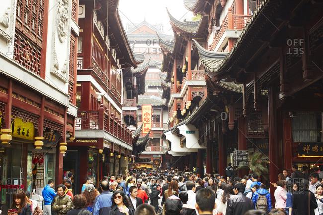 Shanghai, China - April 7, 2014: Crowded streets near Yu Garden and the City God Temple