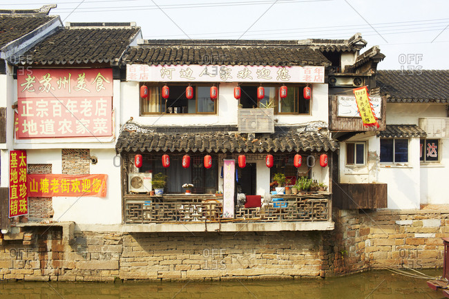 Shanghai, China - April 9, 2014: Riverside building with red lanterns
