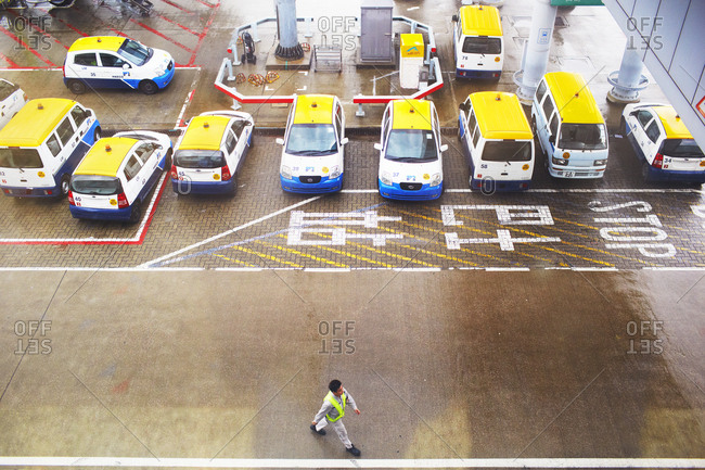 Beijing, China - April 2, 2014: Elevate view over man walking in parking garage