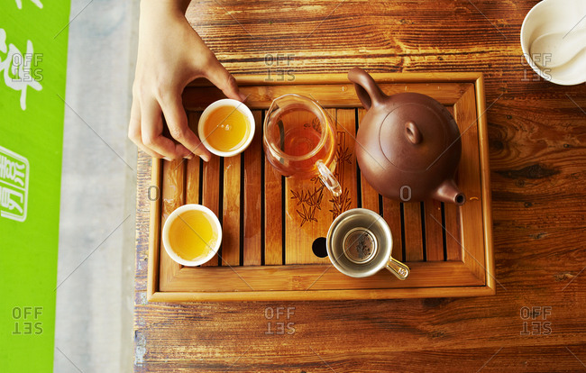 Shanghai, China - April 6, 2014: Overhead view of tea on a wooden tray