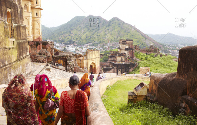 Jaipur, India - August 27, 2013: Rear view of women walking down steps at the Amer Fort