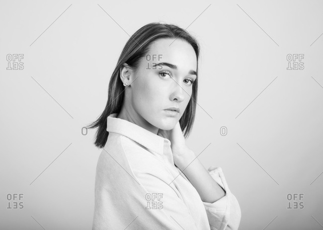 Black and white portrait of a brunette woman in front of light background