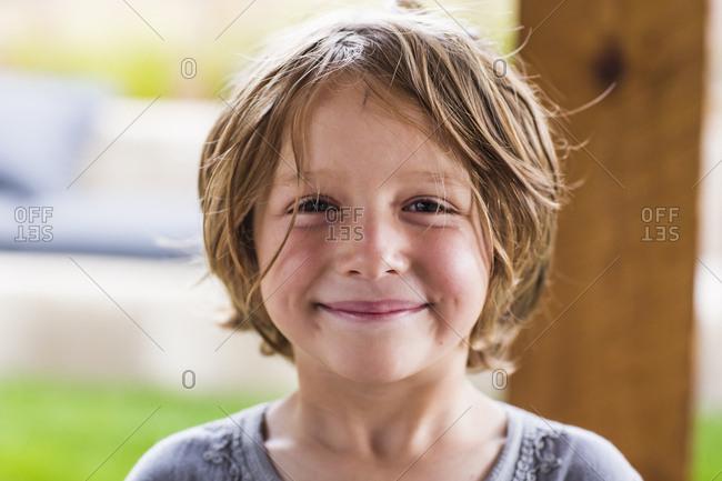 5 year old boy smiling at camera