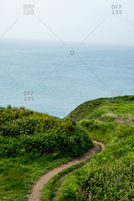 View along hiking trail on a cliff on the Pembrokeshire Coast, Wales, UK.