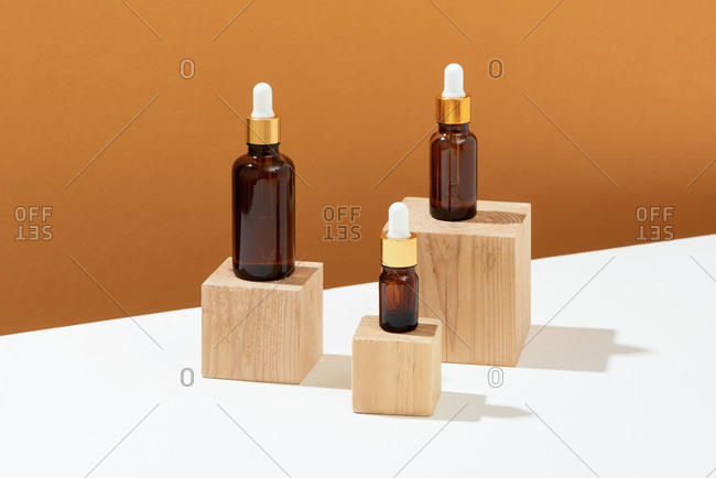 Set of organic cosmetic oil bottles on table