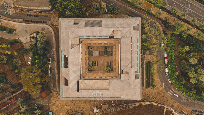 April 8, 2019: Aerial view of abstract beautiful rectangular house with patio surrounded by colorful green trees in Malaga, Spain