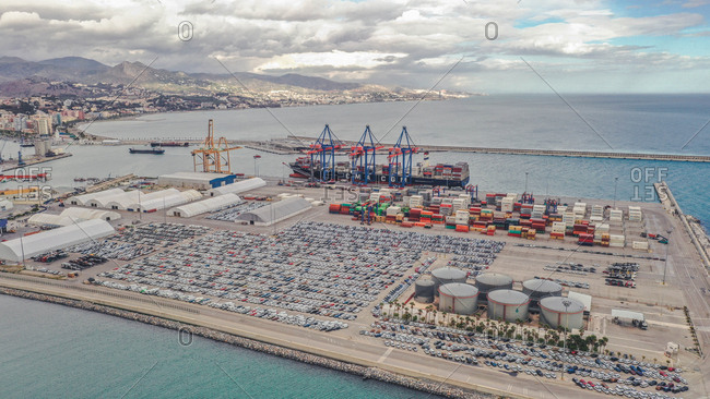 April 8, 2019: Aerial view of beautifully well organized port with colorful containers and large ship in Malaga, Spain