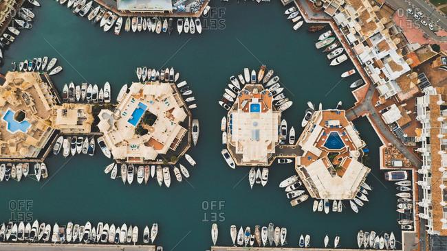 Aerial view of boats parked along circular houses in a beautiful harbor  Puerto Marina, Benalmadena, Spain