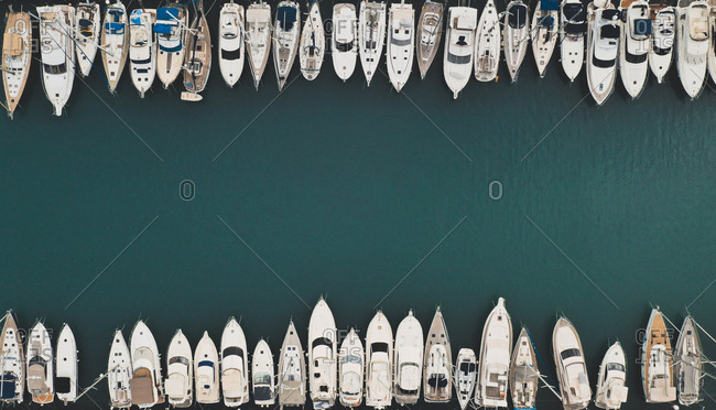 Aerial view of beautiful boats abstractly parked in Puerto Marina, Benalmadena, Spain