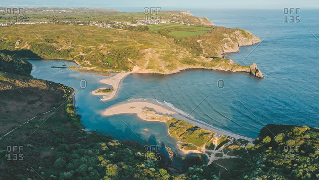 Aerial view of colorful coast and Three Cliffs Bay with beautiful sunlight in near Nicholasto, Wales