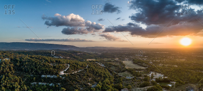 Panoramic aerial view of scenic sunset over Menerbes, France.
