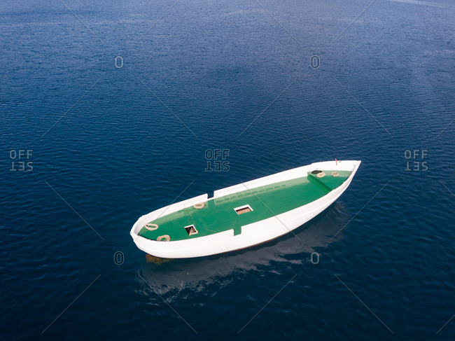 Aerial view of unfinished boat anchored alone at Adriatic sea, Croatia.
