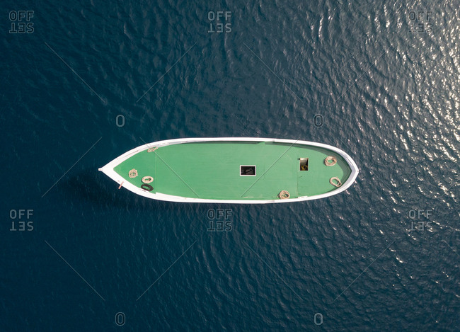 Aerial view above of unfinished boat anchored alone at Adriatic sea, Croatia.