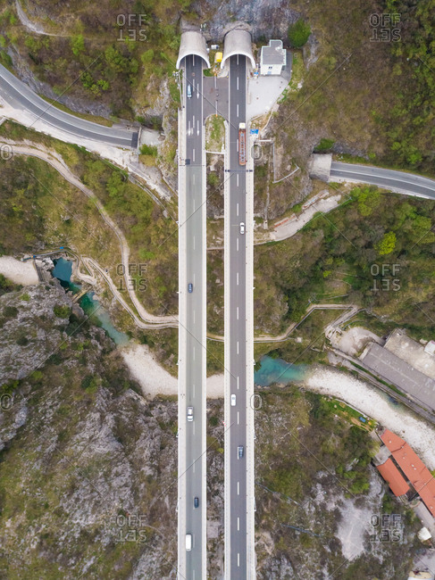 Aerial view of highway crossing river towards tunnel, Rijeka, Croatia.