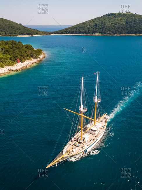 Aerial view of touristic sailing boat crossing the Adriatic sea, Croatia.