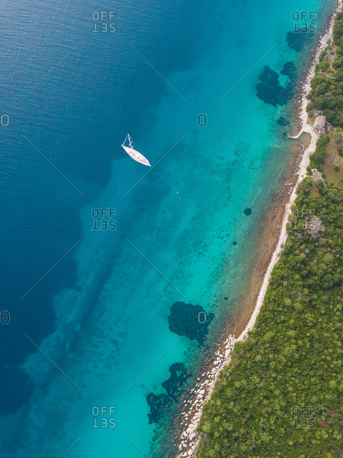 Aerial view of single speed boat floating over transparent water, Croatia.