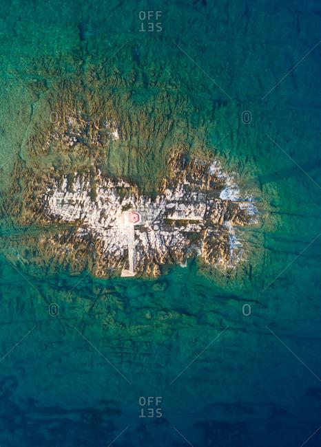 Aerial view of lighthouse at small island near Male Srakane, Croatia.