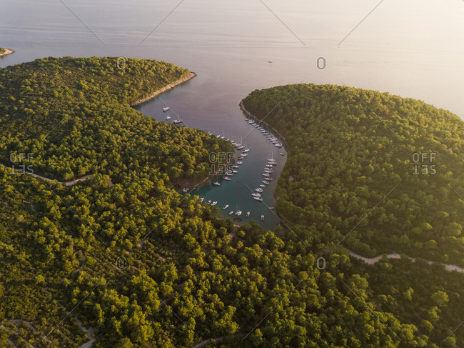 Aerial view of boats anchored at the shore of Krivica, Croatia.