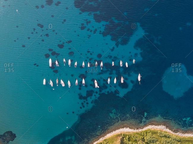 Aerial view of boats anchored at the shore of Susak island, Croatia.