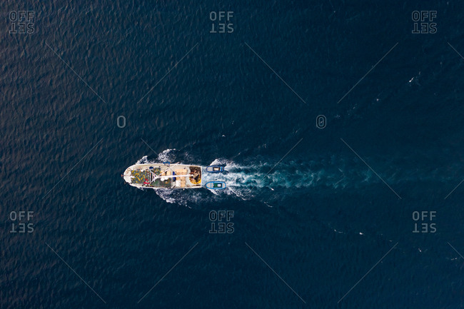 Aerial view of fishing boat sailing at Adriatic sea, Rijeka, Croatia.