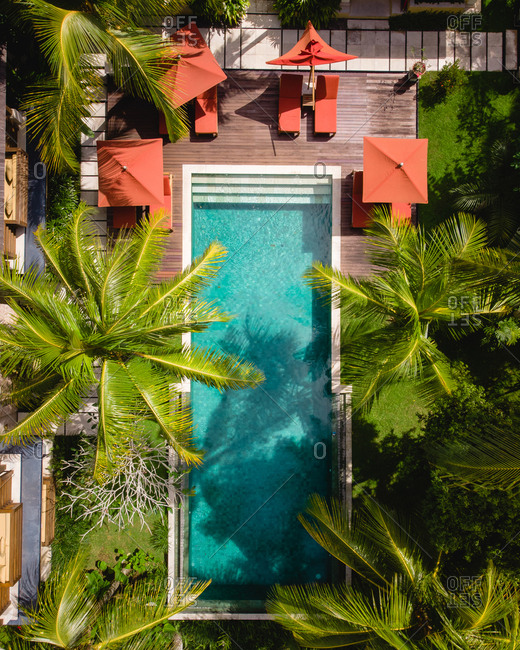 Aerial view of swimming pool at luxury villa in Bali, Indonesia.