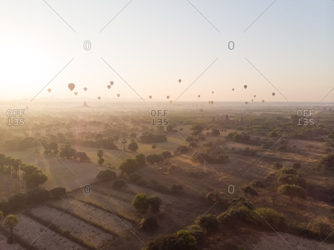 Aerial view of hot balloons flying over Bagan temples in Myanmar.