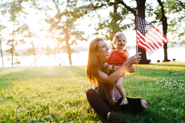 Mom and little girl with American flag