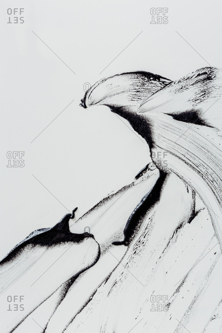 Abstract dark smudges on white background