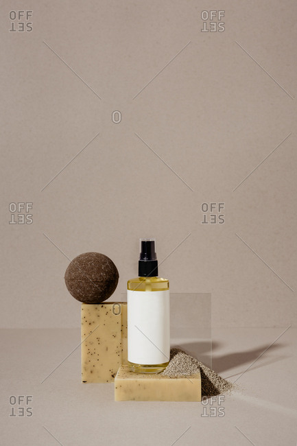 Soaps, oil, and bath bombs on light background