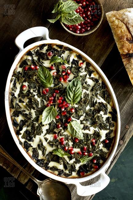 Cheesy broccoli wild rice casserole with crispy basil